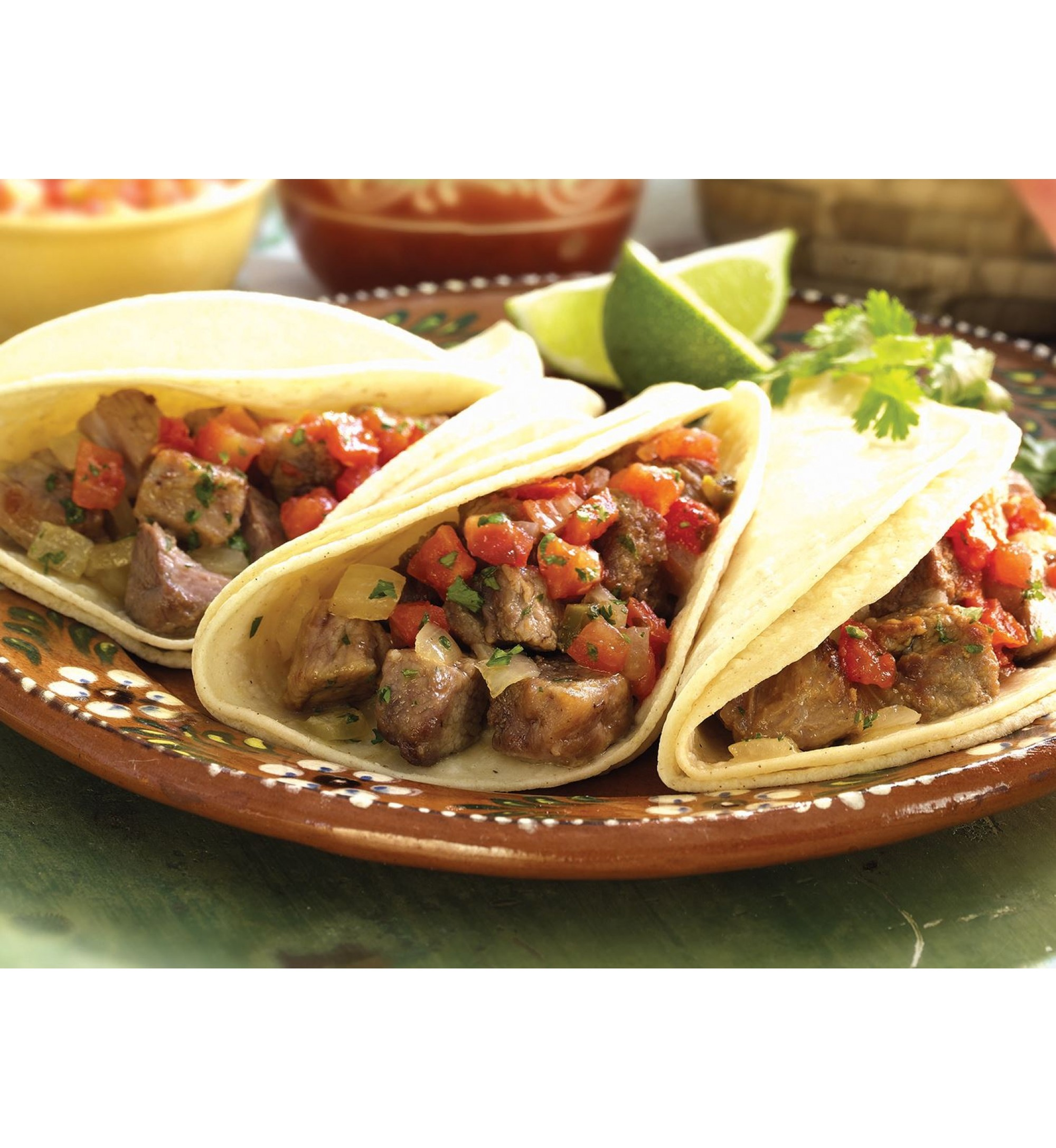 Carnitas – Pork slow cooked over an open fire; flavored with Nonnie's secret blend of spices with cheese & tortillas